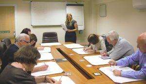 In company training in boardroom setting