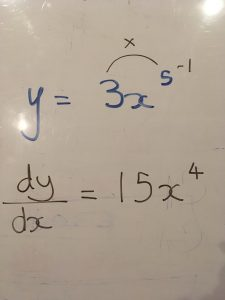 Image of a differentiation question written out on a whiteboard